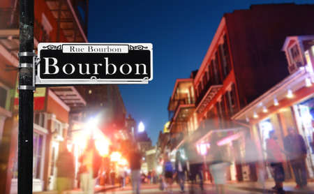 Tourists walk along Bourbon St in New Orleans French Quarter at night Standard-Bild