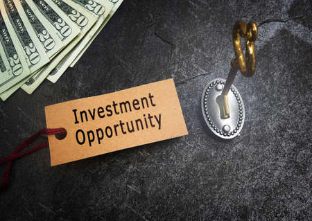 Investment Opportunity tag with cash, gold key and lock