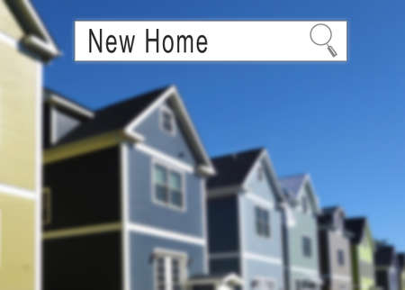 Internet search window with New Home text and neighborhood homes in the background