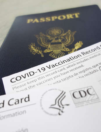 US passport with COVID-19 Vaccination Record Cards, issued by the United States CDC to indicate an individial has been vaccinated against the Coronavirus Stock fotó