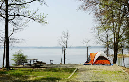 A tent at a waterfront campsite of Jordan Lake State Park  -- Poplar Point campground -- near Raleigh North Carolina