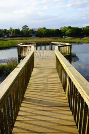 A wooden walkway over the marsh in Folly Beach SC, just south of Charleston