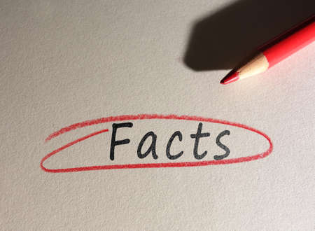 Facts text circled in red pencil on textured paper