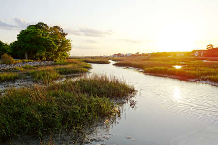 View of coastal homes along the marsh waterways in the Low Country near Charleston SC at sunset