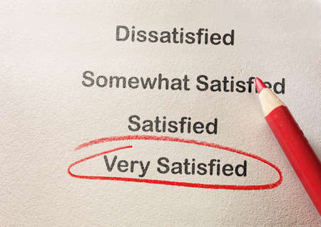 Customer satisfaction survey with Very Satisfied text circled in red pencil Stock fotó