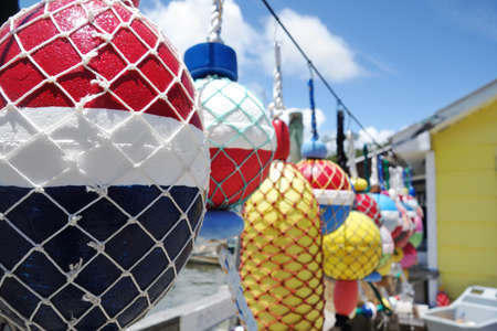 Colorful buoys hanging on a dock in Southport North Carolina