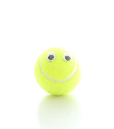 Cute smiling tennis ball with googly eyes on white