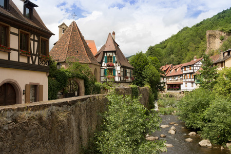 roof framing: At 8 km from Colmar, Kaysersberg is a famous tourist centre with medieval architecture.