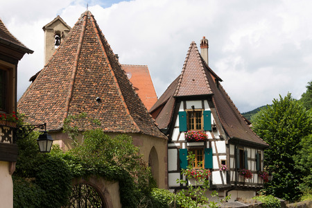 roof framing: At 8 km from Colmar Kaysersberg is a famous tourist centre with medieval architecture. Stock Photo