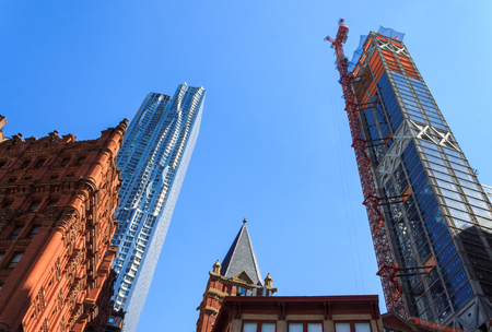 constraction: Skyscraper and constraction on sky background in Manhattan, New-York, USA