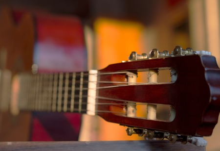 guitar tuner: Guitar headstock, close up, with very shallow depth of field, focus on headstock