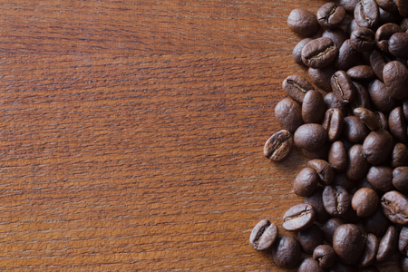 coffeetree: Coffee beans on wood background, copy space