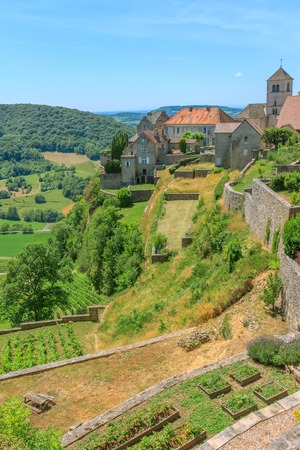 jura: View of the medieval village in valley. Chalon, Departement Jura, Franche-Comte, France