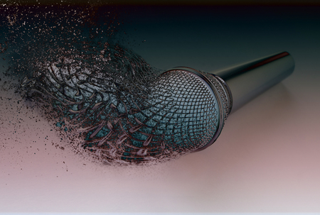 Exploding microphone bursting disperse in pieces fragments Stock Photo