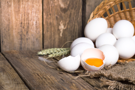 White eggs from the basket and broken egg