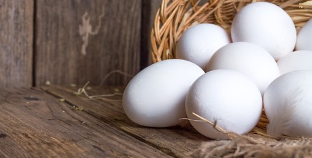 White eggs from the basket on table