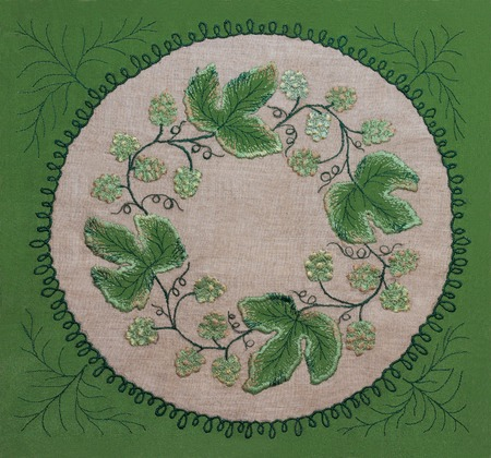 Frame of embroidery green leaves and flowers Stock Photo