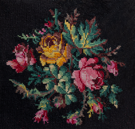 Cross-stitch the bouquet of roses and leafs on black background.