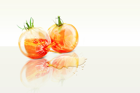 exploded: Two ripe tomatoes ripe collided and one of them exploded spraying juice Stock Photo