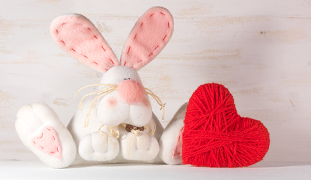 st  valentine: Soft toy rabbit with heart. St. Valentine Day concept