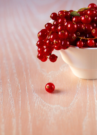 bacca: Red currant on the wooden background Stock Photo