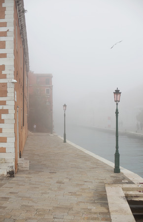 improbable: Fog street in Venice, near Arsenale, Italy Stock Photo