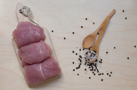 morsel: turkey on wooden background with condiment and two wooden spoons