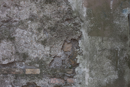 mustiness: Old street textured wall from stone in Rome