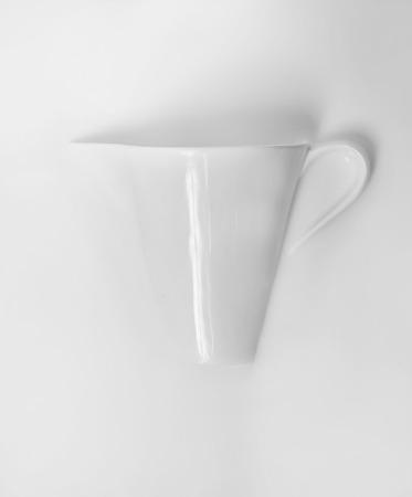 the milk jug: half milk jug in milk Stock Photo