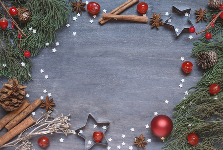 sugar cone: Christmas background with cone, anise tree, cinnamon, cooking cutter and stars from sugar