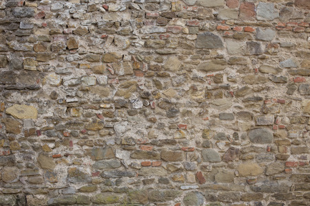 ruinous: Antique street wall from bricks in Arezzo, Italy