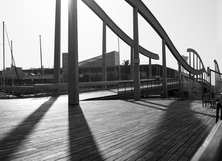 rambla: Black and white photo of Waved bridge Rambla del Mar in Barcelona, Spain Stock Photo
