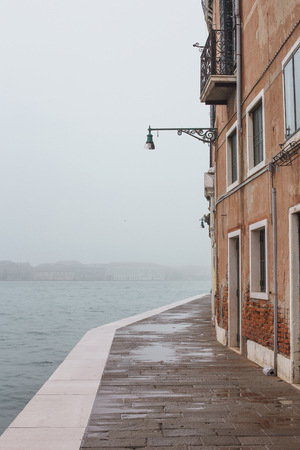 improbable: Fog Venice street with view on Giudecca island, Italy