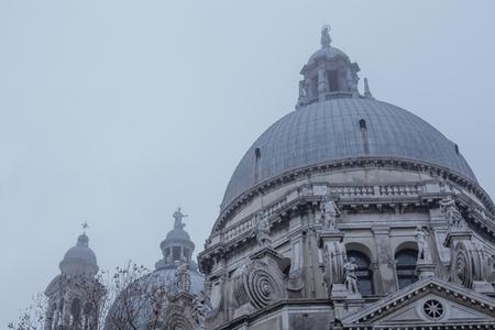View of Santa Maria della Salute in fog. Venice, Italy