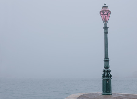 improbable: Fog view with lamp from Dogana in Venice, Italy