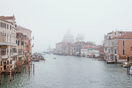 improbable: View of Grand canal with Santa Maria della Saluta in fog. Venice, Italy Stock Photo