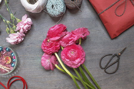 market bottom: Some peonies with red gift pack and vintage scissors. Top view