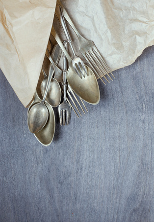 vintage cutlery: Vintage cutlery on wooden background. Top view