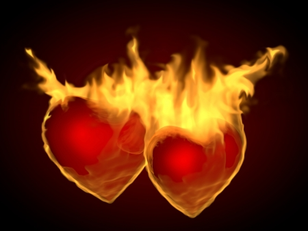 flaming: Two flaming hearts on fire, on a dark background Stock Photo