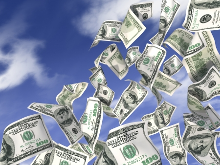 Dollars are flying against the blue sky photo