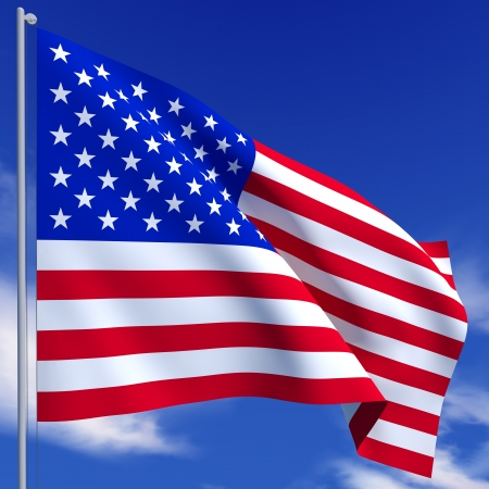 The American flag flies on a background of blue sky photo