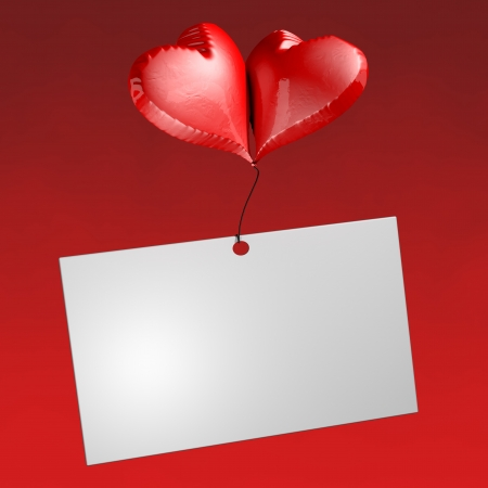 Two heart-shaped balloons support a ticket the background is blurred Stock Photo - 17288870