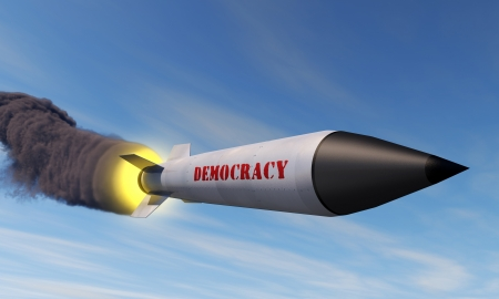 A missile with a trail of smoke and the word democracy in the side Standard-Bild