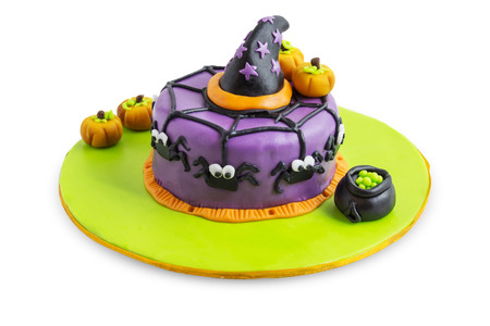A cake decorated for halloween with spiders, pumpkins and stars.