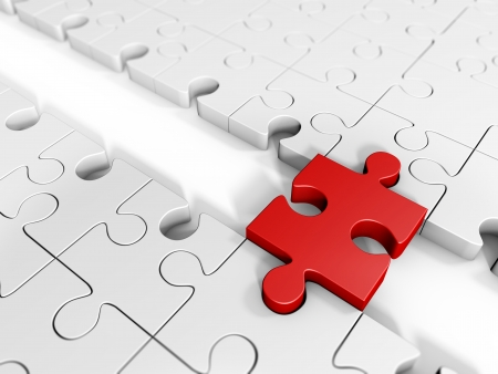 A piece of red puzzle with a bridge joining two large groups of puzzle Stock Photo