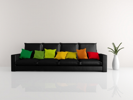 A room with a minimalist black sofa covered in colorful pillows and a vase of flowers