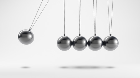 Metal pendulum with five stationary and a moving spheres Stock Photo