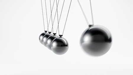 Metal pendulum with five stationary and a moving spheres Standard-Bild