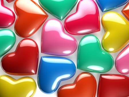 A group of reflective hearts of various colors photo