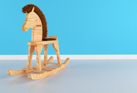 babyroom: Wooden rocking horse with brown mane in a bedroom Stock Photo